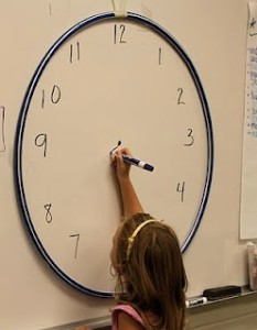 Use a hoola-hoop to create a big class clock.