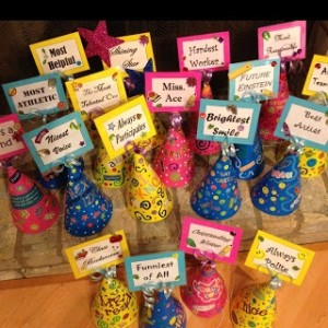 Students can design their own award hats after receiving the awards.